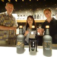 David Croll, founding partner of Kyoto Distillery (left), enjoys a glass of Ki no Bi gin with his colleagues in August. | ERIC JOHNSTON