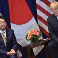 Prime Minister Shinzo Abe and U.S. President Donald Trump on Wednesday agreed to start bilateral negotiations on a trade agreement on goods, but reaching a deal won't be easy. | AFP-JIJI