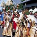 March of the merrymakers: A parade of men dressed in makeshift samurai outfits march in honor of samurai Yanobe Heiroku.