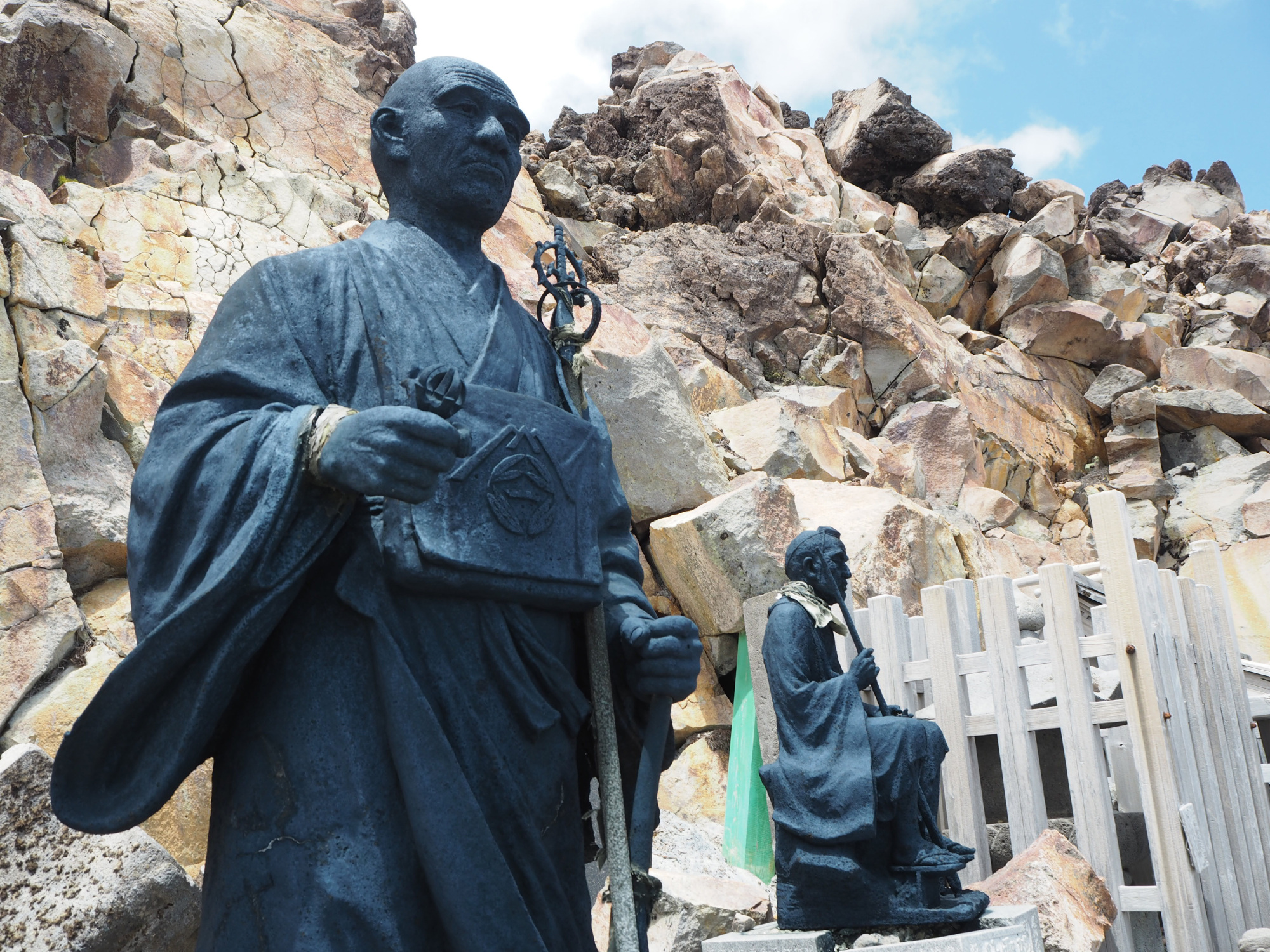Summit approach: Stone statues at a shrine at one of the minor summits of Mount Ontake. | TOM FAY