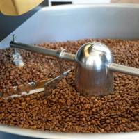 Post roast: Coffee beans are gently stirred and brought down to room temperature on a cooling sieve before storage. | CLAIRE WILLIAMSON
