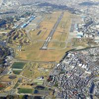 Air space: Naval Air Facility Atsugi in Kanagawa Prefecture sits in the Yokota Radar Approach Control airspace monitored by the U.S. military. The huge, arrow-shaped area extends beyond Maebashi, Gunma Prefecture, almost to the Sea of Japan, and covers parts of nine prefectures. | KYODO