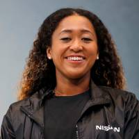 Rising star: U.S. Open tennis champion Naomi Osaka attends a contract signing ceremony at Nissan's global headquarters in Yokohama on Sept. 13. | REUTERS