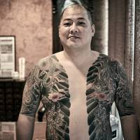 Body sleeves: A yakuza displays his tattoos, with four dragons and a motif of lightning bolts.   COURTESY OF ANDREAS JOHANSSON