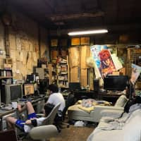 The video-gaming room, home of numerous retro games, as well as plenty of cigarette butts and sleep-deprived residents. | VICTOR CHAIX