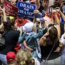 Supporters and protesters scuffle during a rally staged by U.S. President Donald Trump in Tampa, Florida, on July 31