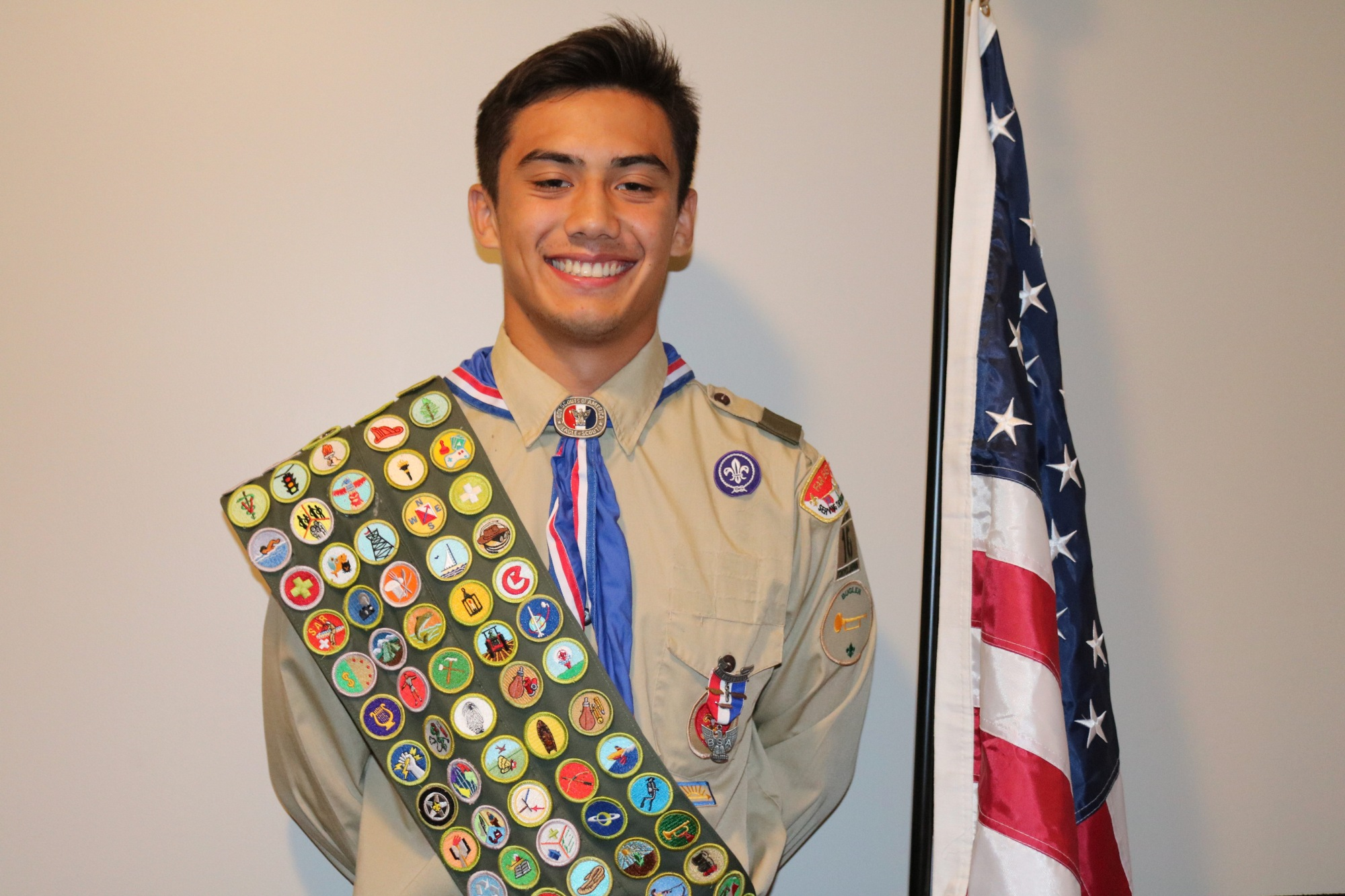 He has his merits: Eagle Scout Austin Koslow wears his full complement of 137 merit badges. | MARGARET GOFF