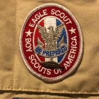 The Eagle Scout and Arrow of Light badges | MARGARET GOFF