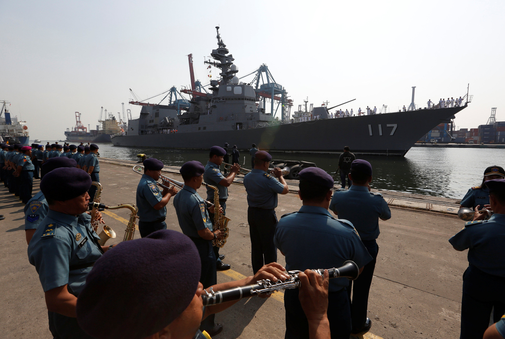 An Indonesian Navy band welcomes the Maritime Self-Defense Force destroyer Suzutsuki as it arrives in Jakarta on Sept. 18 as part of a two month Indo-Pacific tour with the helicopter carrier Kaga and the destroyer Inazuma. | REUTERS