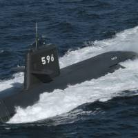 After participating in an anti-submarine exercise in the South China Sea with three other Japanese warships, the Maritime Self-Defense Force submarine Kuroshio began a five-day port call in Vietnam on Monday — a first for the two nations. | MARITIME SELF-DEFENSE FORCE / VIA KYODO