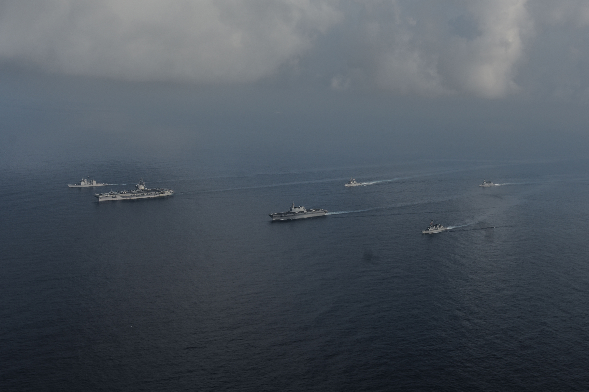 The Maritime Self-Defense Force helicopter carrier Kaga and destroyers Inazuma and Suzutsuki sail with the USS Ronald Reagan aircraft carrier and two other U.S. warships in the South China Sea on Aug. 31. | U.S. NAVY