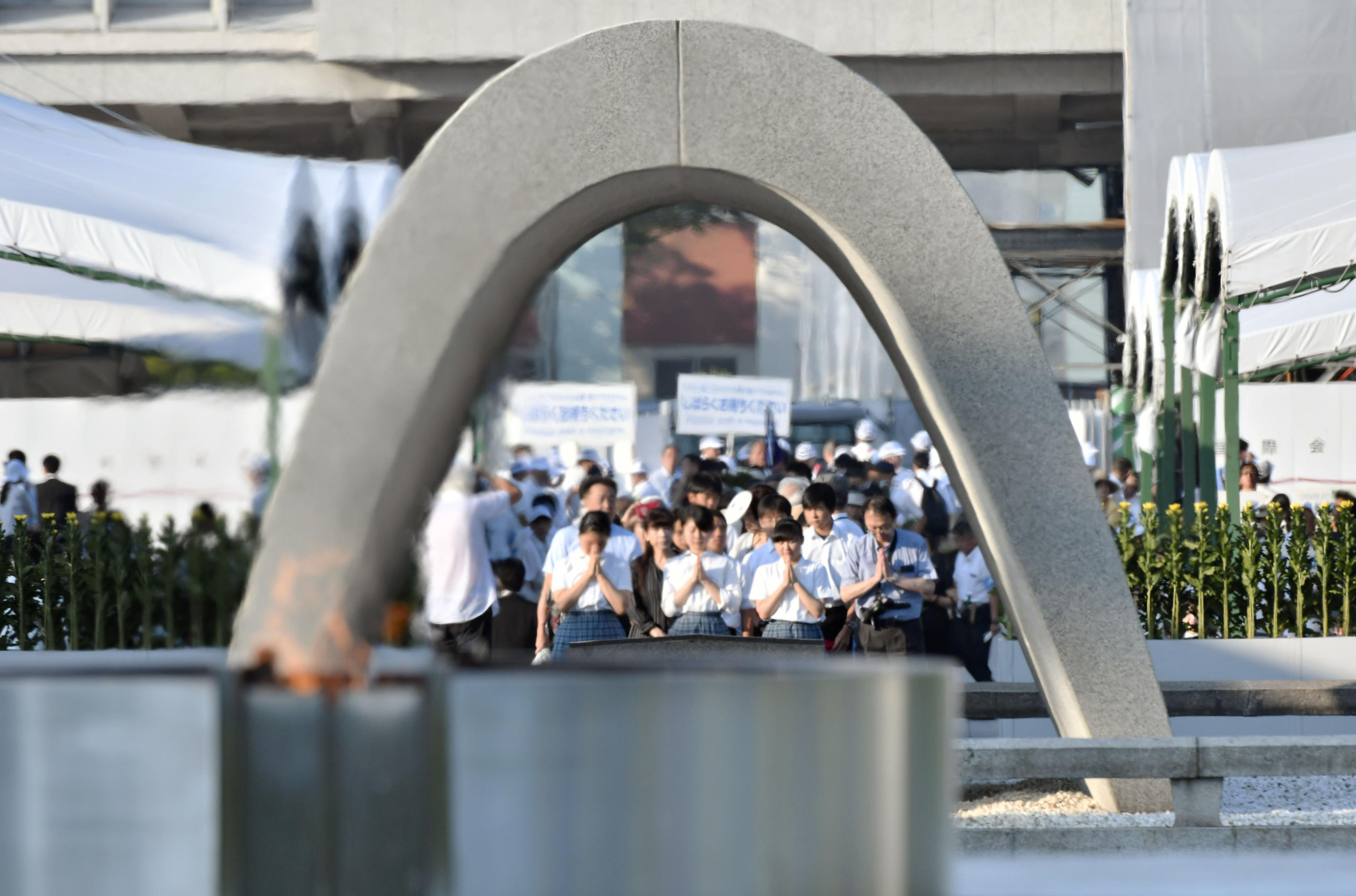 People pray in front of the Cenotaph for A-bomb Victims in the city of Hiroshima on Aug. 6.   KYODO