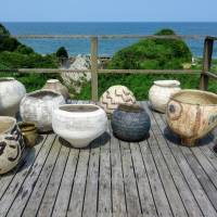 A collection of tsubo (clay jars) on the balcony of Kazunori Hamana's home overlooking the sea in Isumi, Chiba Prefecture. | LILY CROSSLEY-BAXTER