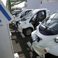 Toyota super-compact electric vehicles are charged at the Smart Mobility Park electric mobility charging station Toyota, Aichi Prefecture. | BLOOMBERG