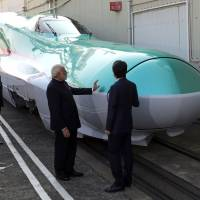 Indian Prime Minister Narendra Modi and Prime Minister Shinzo Abe inspect an E5 series bullet train locomotive at a Kawasaki Heavy Industries plant in Kobe in November 2016. Modi picked Japan as a partner for India's first high-speed rail line.   BLOOMBERG
