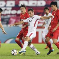 The Antlers'  Serginho, who scored Kashima's opening goal in the 14th minute, controls the ball against Tianjin Quanjian in an Asian Champions League quarterfinal, second-leg match on Tuesday in Macau. Kashima won 3-O. KYODO