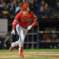 Los Angeles designated hitter Shohei Ohtani watches his three-run homer against Chicago leave the yard in the third inning on Friday night. | USA TODAY / VIA REUTERS