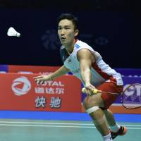 Kento Momota competes against Indonesia's Anthony Sinisuka Ginting in the China Open men's singles final on Sunday.