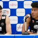 Rui Hachimura (right) speaks at a news conference on Sunday as Yuta Watanabe listens.