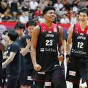 Rui Hachimura (center) and Yuta Watanabe (right) were all smiles after Japan's 70-56 win over Iran on Monday at Ota City General Gymnasium.