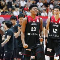 Rui Hachimura (center) and Yuta Watanabe (right) were all smiles after Japan's 70-56 win over Iran on Monday at Ota City General Gymnasium. | KYODO
