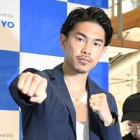 Kazuto Ioka poses during a news conference on July 20 in Tokyo. | KYODO