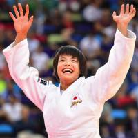 Uta Abe celebrates after winning the gold medal in the women's under-52 kg category at the World Judo Championships in Baku on Friday.