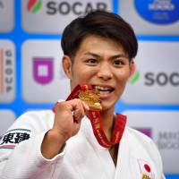 Hifumi Abe poses with his gold medal from the men's under-66 kg category at the World Judo Championships on Friday.