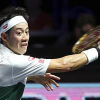 Kei Nishikori hits a return to Nikoloz Basilashvili in the Moselle Open quarterfinals on Friday in Metz, France. Nishikori won 6-3, 4-6, 6-4. | KYODO