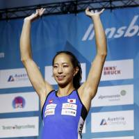 Akiyo Noguchi celebrates after finishing as the runner-up in the women's bouldering final at the IFSC Climbing World Championships on Friday in Innsbruck, Austria. | KYODO