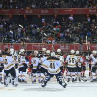 Boston Bruins celebrate their victory over the Calgary Flames in the NHL China Games on Saturday in Shenzhen, China. AFP-JIJI