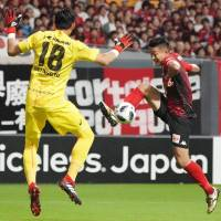 Consadole Sapporo's Ken Tokura scores a second-half goal against Vissel Kobe on Saturday at Sapporo Dome. Consadole won 3-1. | KYODO