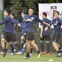 Members of the Japanese national team train on Sunday in Osaka. | KYODO