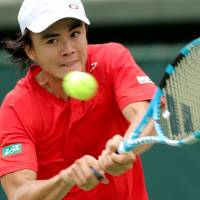 Japan's Taro Daniel hits a return to Bosnia-Herzegovina's Tomislav Brkic in their Davis Cup World Group playoff singles match on Friday in Osaka. | AFP-JIJI