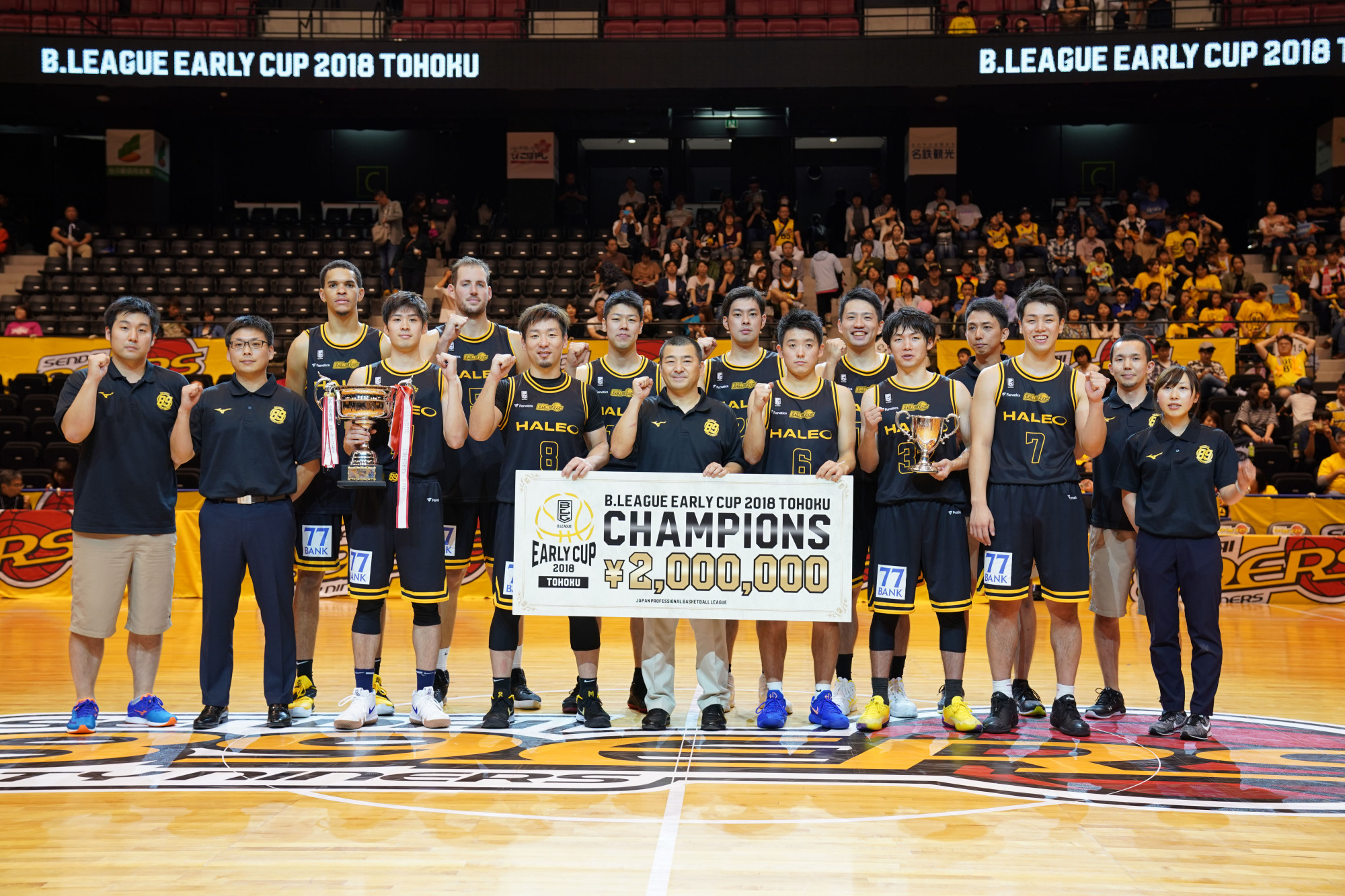 The Sendai 89ers celebrate winning the B. League Early Cup Tohoku title on Sunday at Xebio Arena. | B. LEAGUE