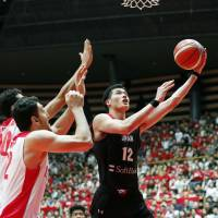 Japan's Yuta Watanabe goes up for a shot against Iran in a FIBA World Cup qualifier on Monday. Watanabe scored 18 points as Japan won 70-56. | KYODO