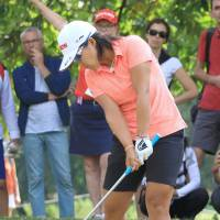 Nasa Hataoka hits a shot from the rough on the 10th hole during the final round of the Evian Championship on Sunday. | KYODO