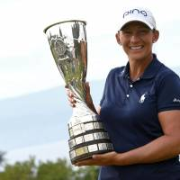 Angela Stanford poses with the trophy after winning her first major title on Sunday at the Evian Championship in Evian-Les-Bains, France. | AFP-JIJI