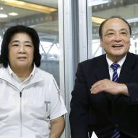 Chieko Tsukahara (left) and husband Mitsuo pose before an interview. The two, who were suspended from senior positions at the Japan Gymnastics Association on Monday, have denied allegations that they harassed Olympic gymnast Sae Miyakawa. | KYODO
