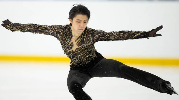 Two-time Olympic champ Yuzuru Hanyu wins in return to competition