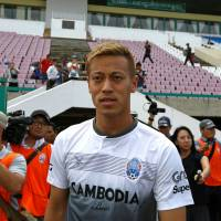 Former Japan star Keisuke Honda arrives for a Cambodian national team training session at Olympic Stadium in Phnom Penh on Tuesday. | REUTERS