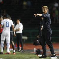 Cambodia general manager Keisuke Honda gives instructions during the friendly match between Cambodia and Malaysia in Phnom Penh on Monday. Malaysia won 3-1. | AP