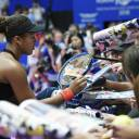 Naomi Osaka signs autographs at the Toray Pan Pacific Open in Tachikawa.