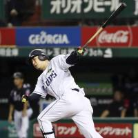 The Lions' Hideto Asamura slaps a tiebreaking seventh-inning against the Marines on Friday night at MetLife Dome. Seibu defeated Chiba Lotte 10-4. | KYODO