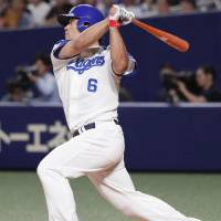The Dragons' Ryosuke Hirata strokes a third-inning double against the Carp on Saturday afternoon at Nagoya Dome. Chunichi defeated Hiroshima 6-5. | KYODO