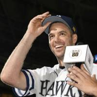 Hawks pitcher Rick van den Hurk participates in the hero interview after the team's win over the Buffaloes on Sunday in Fukuoka. | KYODO