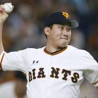 Giants hurler Tomoyuki Sugano delivers a pitch in Saturday's game against the Swallows at Tokyo Dome. Sugano went the distance in Yomiuri's 5-0 win over Tokyo Yakult. | KYODO