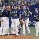 The Swallows celebrate on the mound after their win over the Dragons on Sunday in Nagoya.
