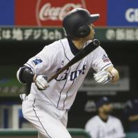 The Lions'  Shogo Akiyama homers in the first inning on Tuesday against the Fighters. KYODO