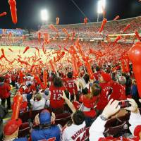 Carp fans release balloons during the seventh inning on Wednesday at Mazda Stadium.   KYODO